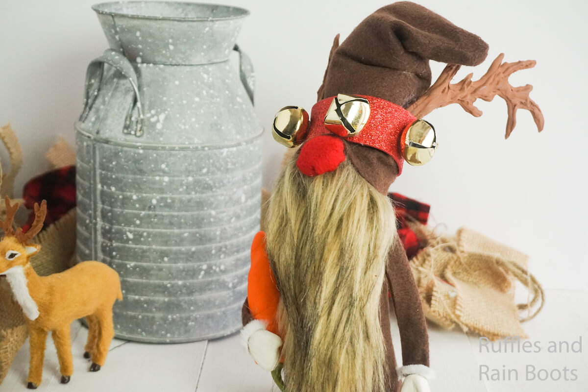 how to make a DIY reindeer gnome on a white background with a tiny deer and a silver milk jug