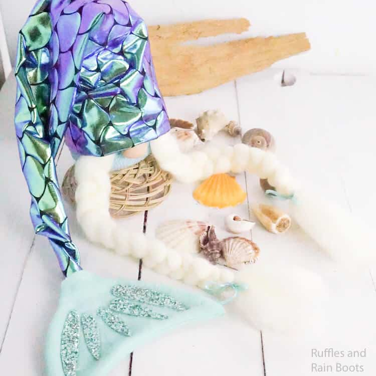 easy diy mermaid gnome on a white background with scattered shells