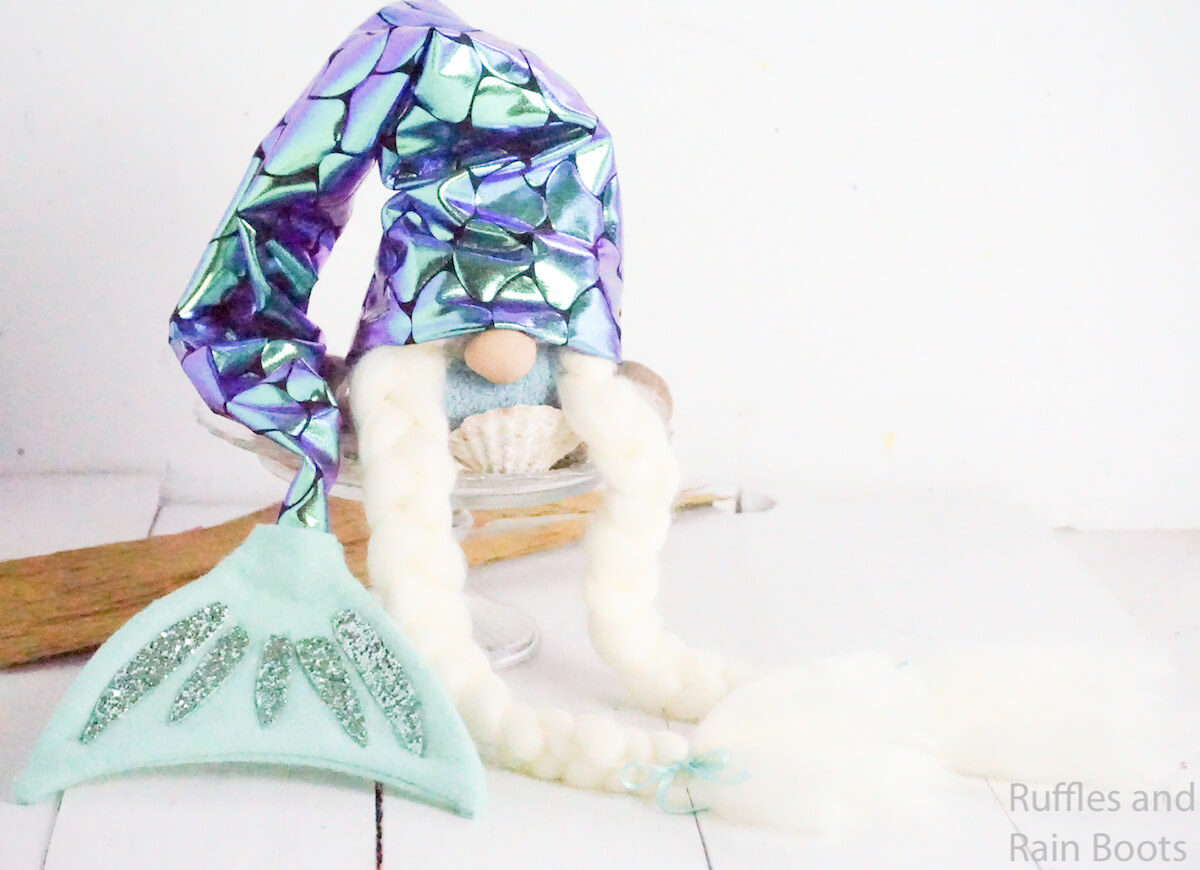 how to make a mermaid gnome with braids on a white background