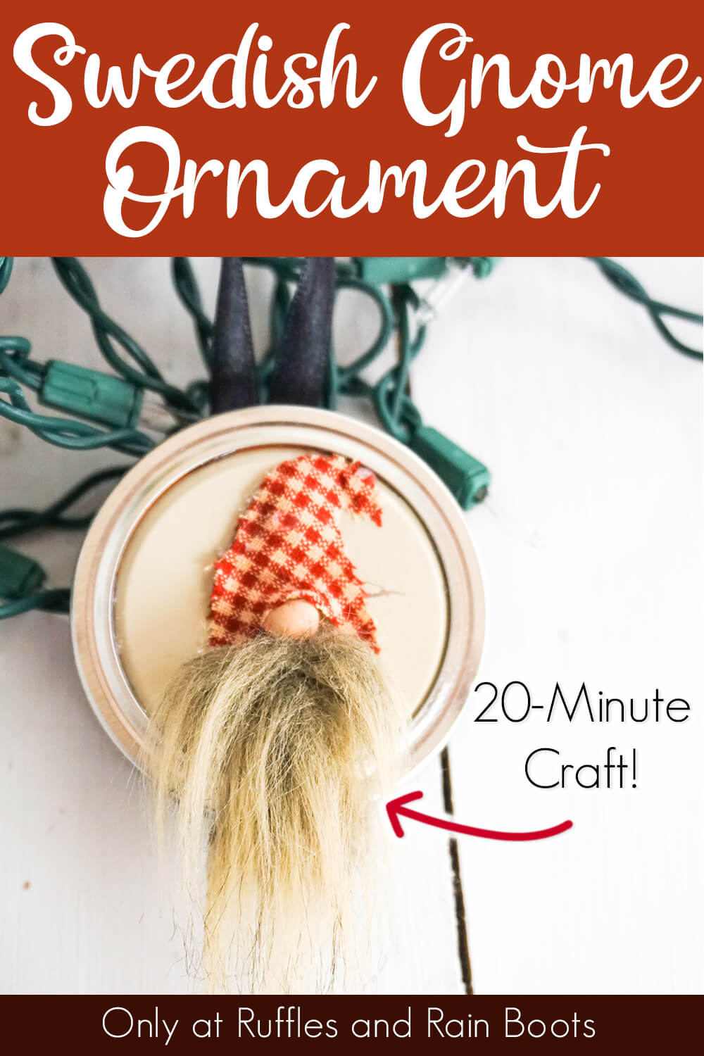 easy ornament made from a mason jar lid with a gnome face on it on a white table with christmas lights with text which reads swedish gnome ornament 20-minute craft