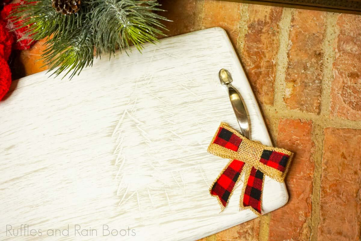 Cutting Board Upcycled Carved Christmas Tray on a brick barckground