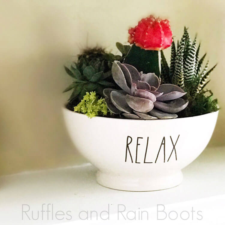 Rae Dunn RELAX Bowl Planter upcycle project on a white table in front of a beige background