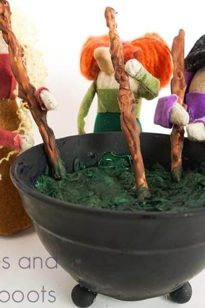 Sanderson Sisters Hocus Pocus Gnomes standing on a white background with a cauldron of green potion