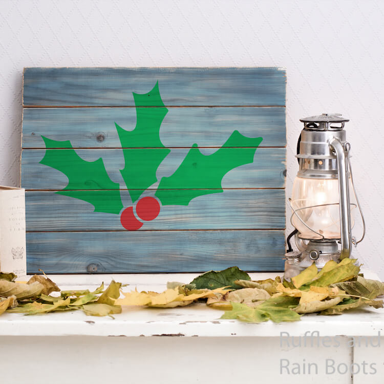 Holly cut file for cricut on Wood Sign on a white mantle in front of a white background