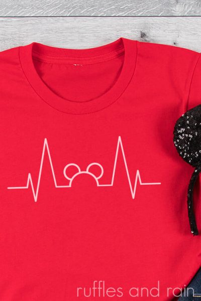 Free Mickey Heartbeat SVG on a red t-shirt on a white background