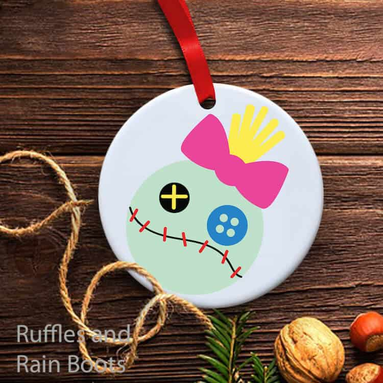 scrump lilo and stitch ornament on a wood background with some twine