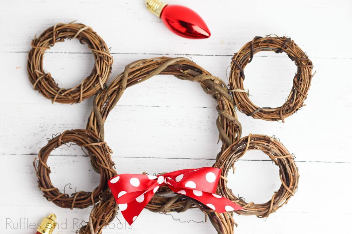 Disney Craft Ideas mickey and minnie wreath on a white wood background