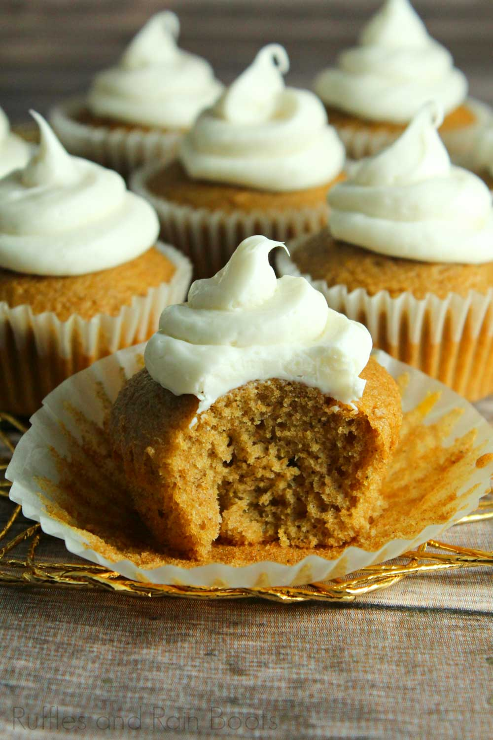 pumpkin eggnog cupcake recipe for Fall closeup of cupcake with a bite taken out