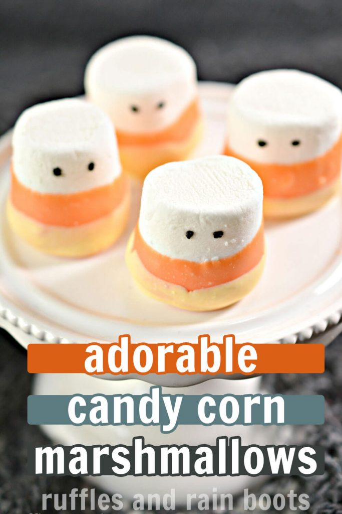 candy corn marshmallow recipe for Halloween on a cupcake platter with text which reads adorable candy corn marshmallows