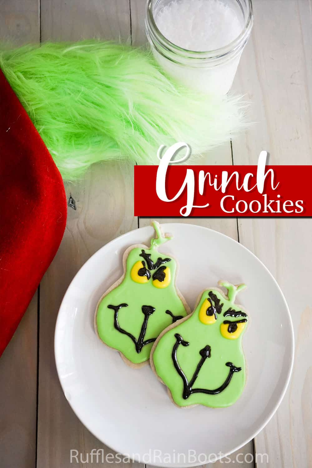 sugar cookies decorated as the grinch with text which reads grinch cookies