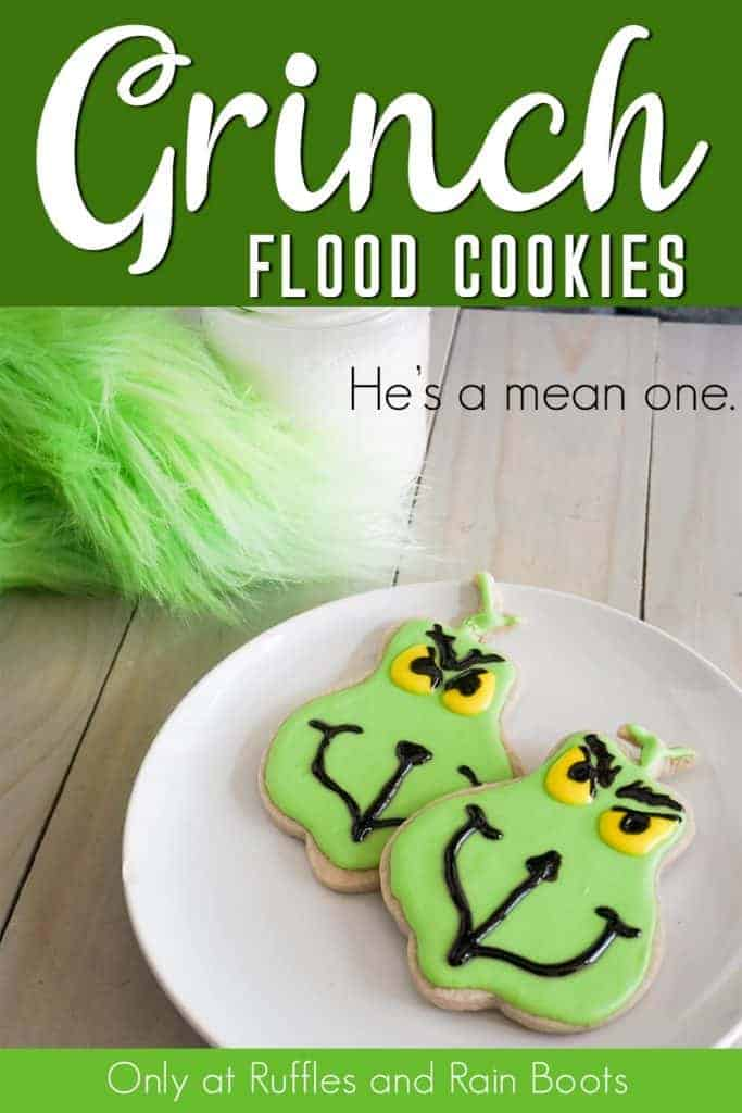 grinch iced sugar cookies on a white plate with text which reads grinch flood cookies he's a mean one