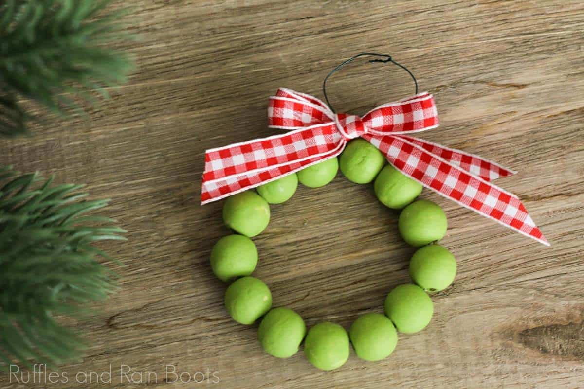 Christmas ornament idea for rustic wood bead wreath on a wood table