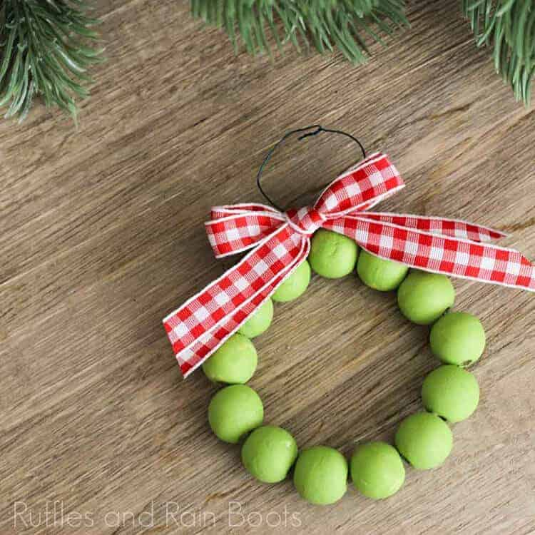 Farmhouse Wood Bead Wreath Ornament on a wood background