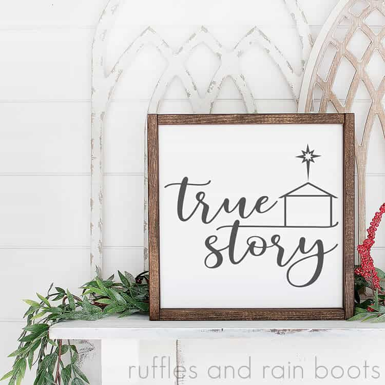 square close up image of true story Christmas SVG on white framed canvas sitting on fireplace mantle decorated for the holidays