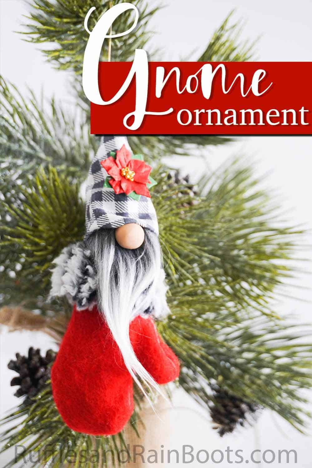 scandinavian gnome ornament hanging on a christmas tree with text which reads gnome ornament