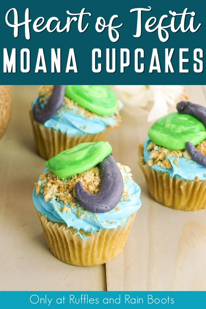overhead vcupcakes for a moana party with text which reads heart of tefiti moana cupcakes