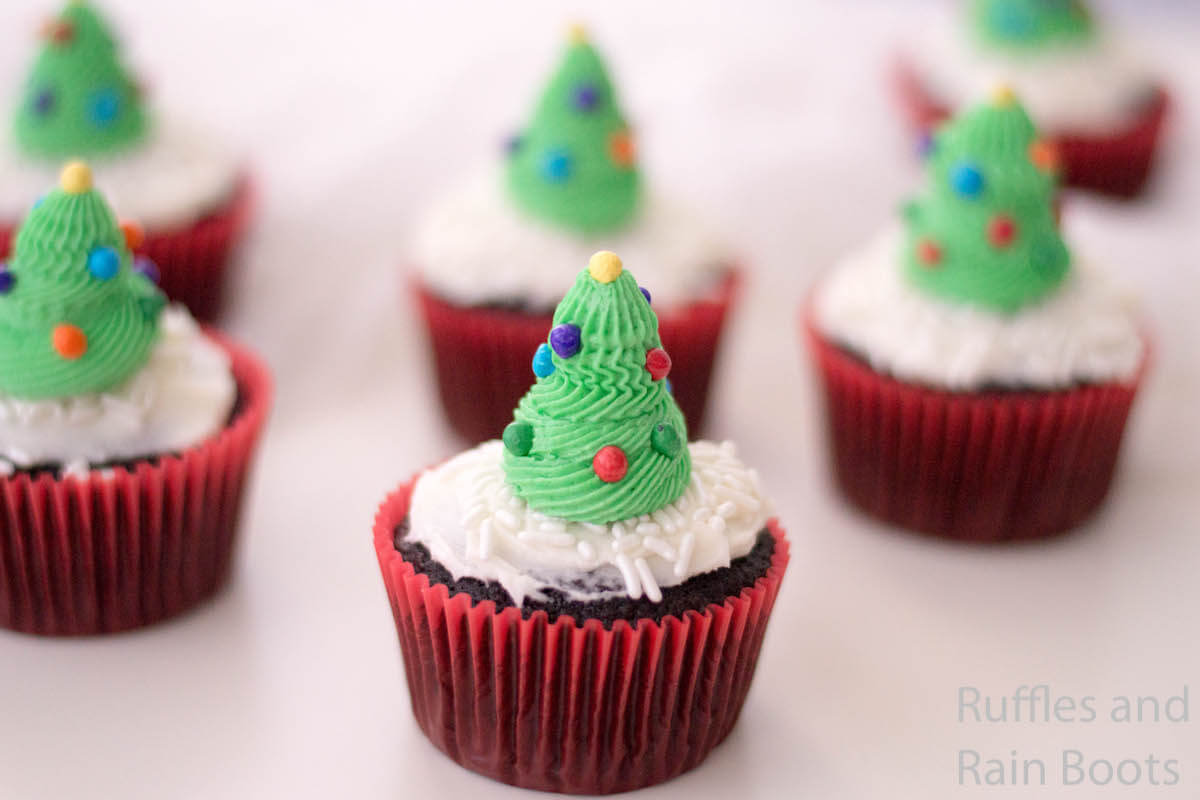 side view of easy recipe for christmas tree cupcakes on a white table