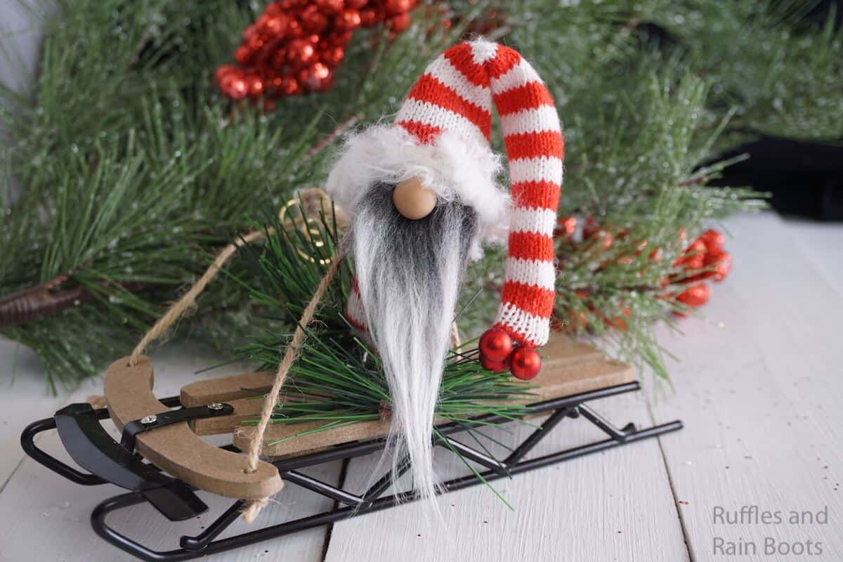 how to make an ornament with a gnome on a sled