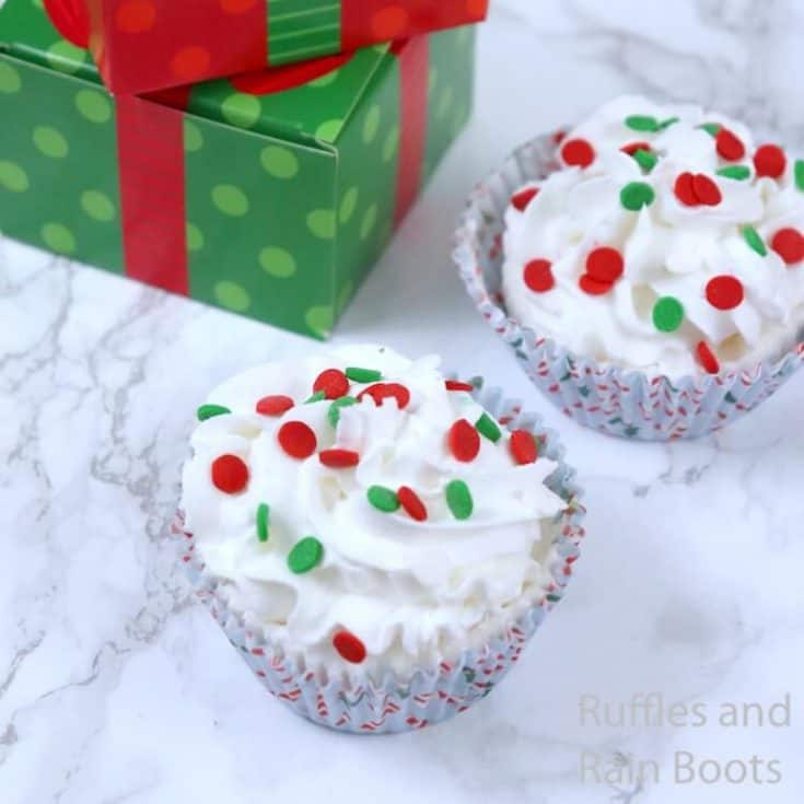 how to make christmas gift bath bombs on a white background with a green present