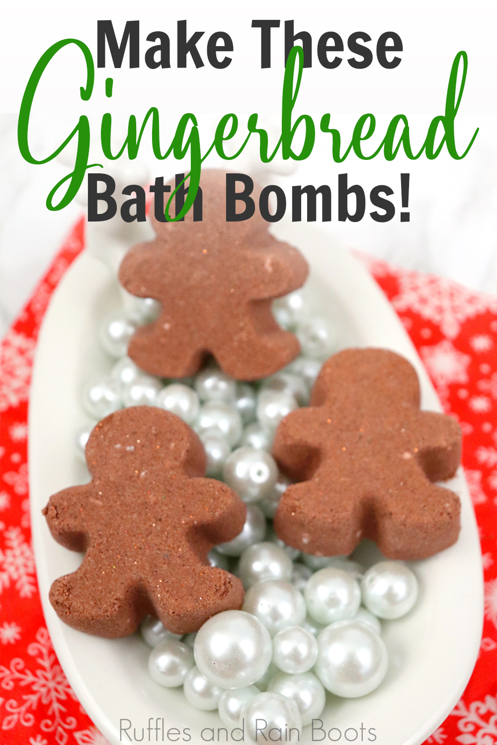three gingerbread men bath bombs in a tiny bathtub with pearls on a red background with text which reads make these gningerbread bath bombs