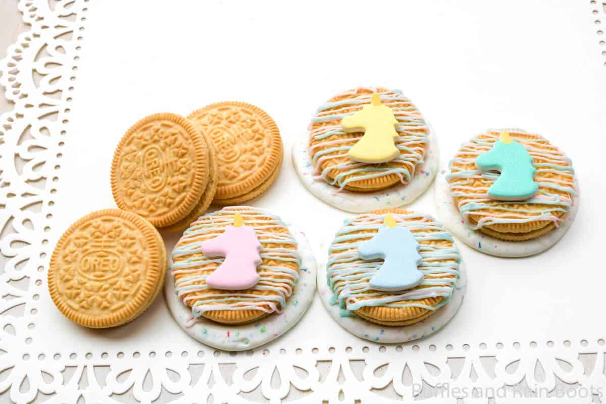 unicorn party cookies on a white lace covered table