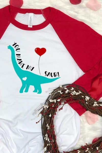 Dinosaur Valentines SVG on Red Raglan T-Shirt