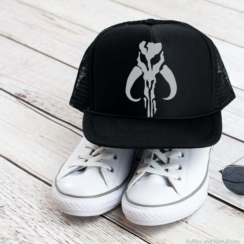 mandalorian skull cut file for cricut or silhouette on a ball cap sitting on shoes
