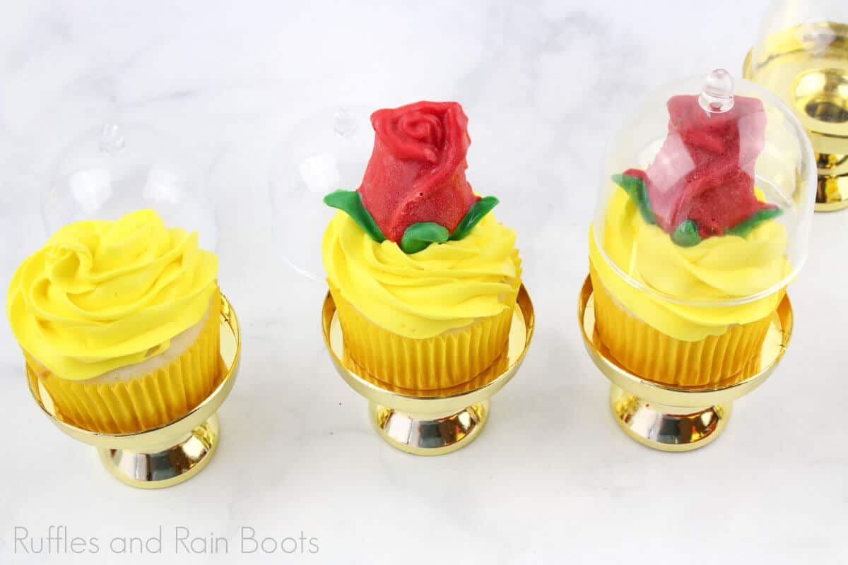 Process photo of how to add the Rose and the glass design over it onto the princess cupcake with a white background