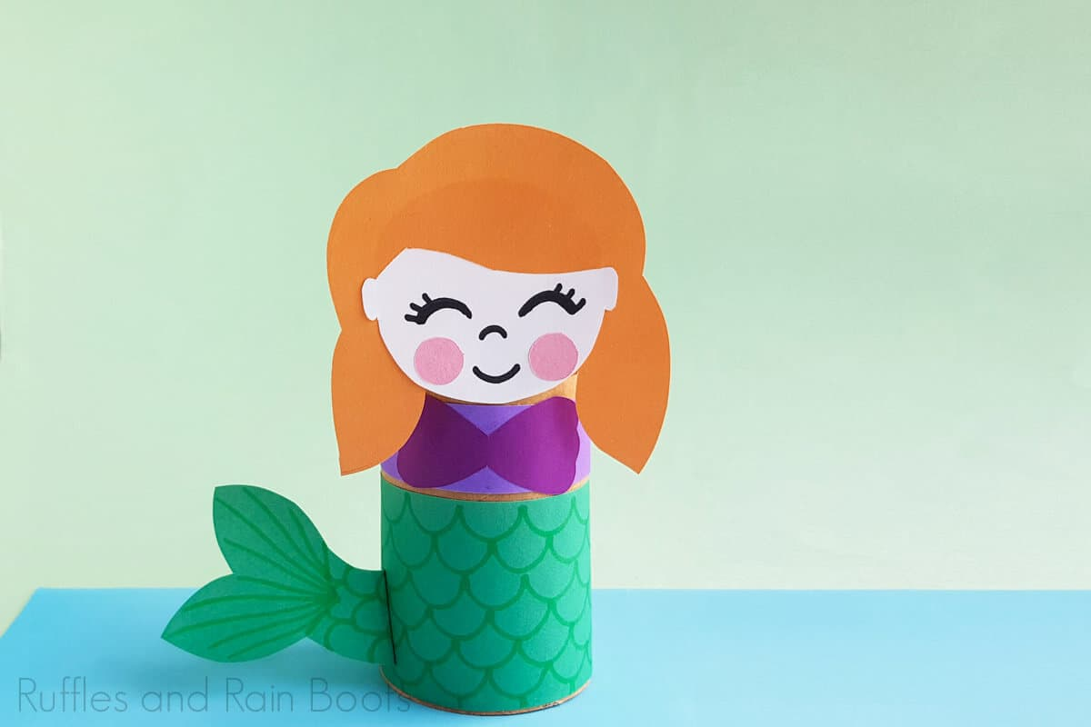 Horizontal image of Princess Ariel on a light green background