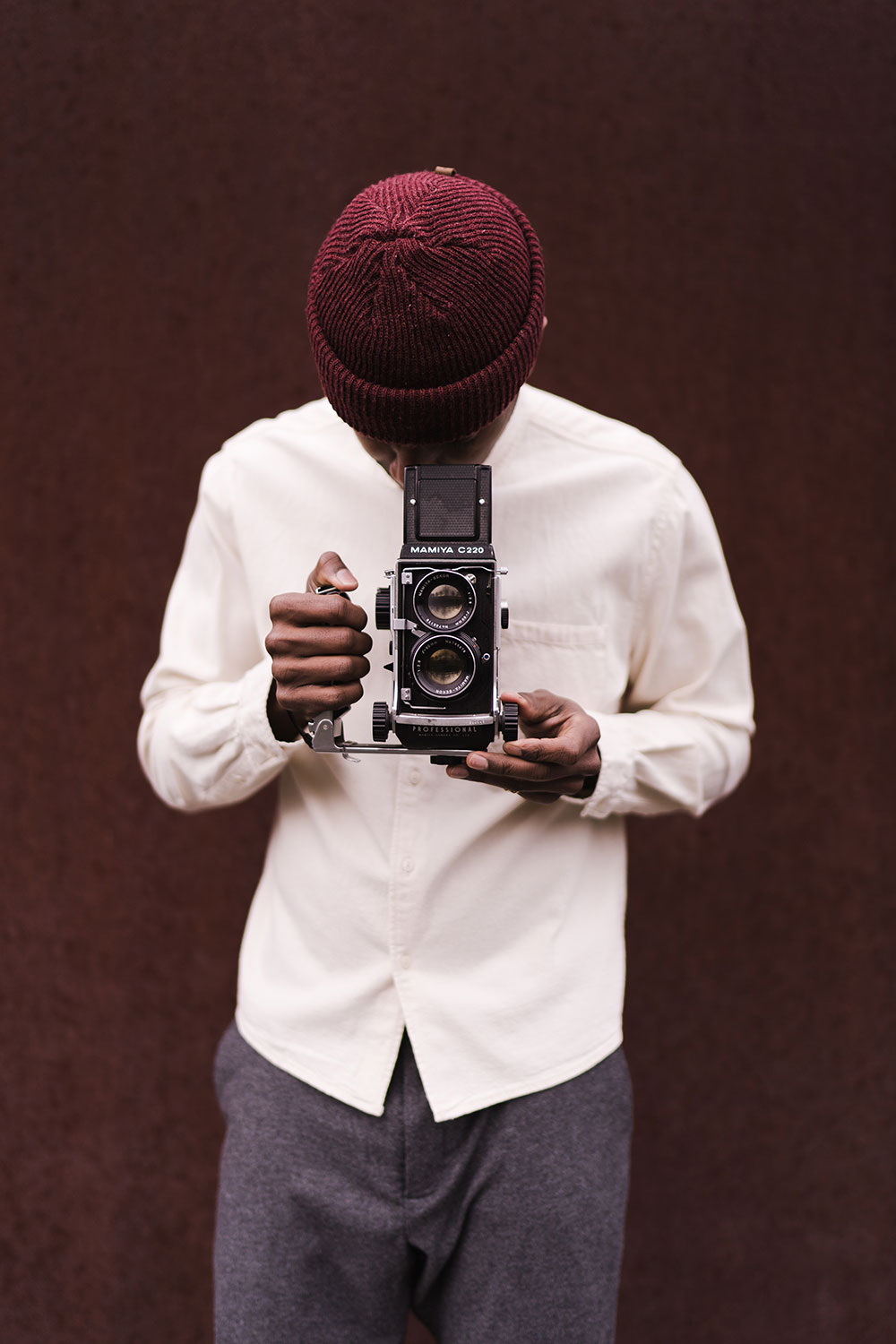 gorgeous portrait of a black man shooting an large-format film camera
