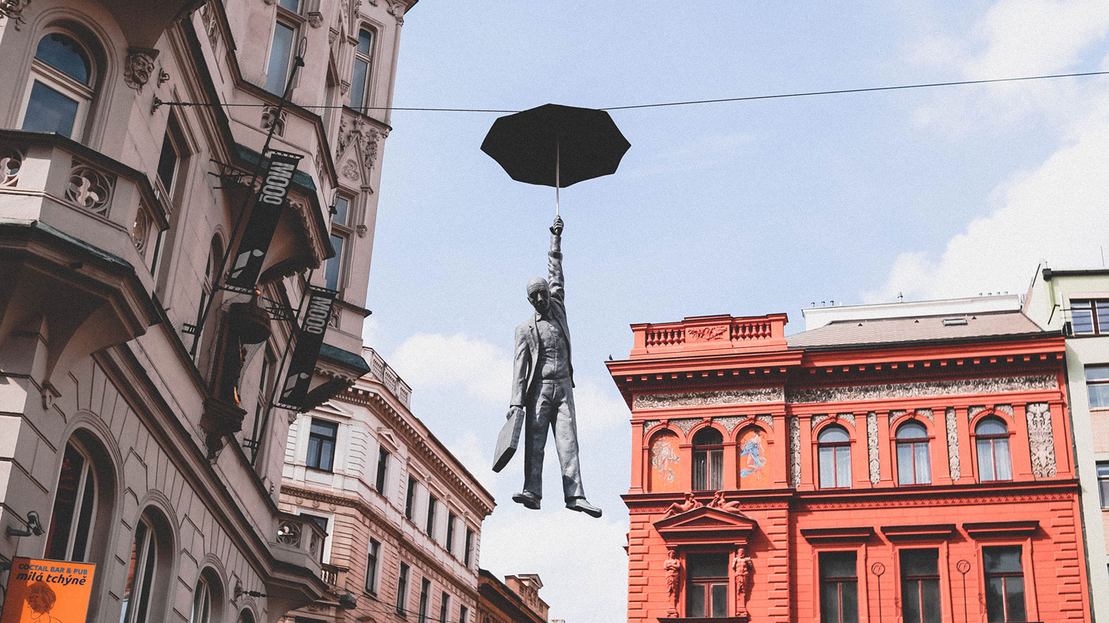 Statue of a man with an umbrella in Prague, Photo by Anastasia Dulgier on Unsplash