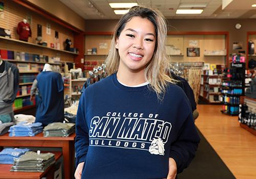 student wearing College of San Mateo Sweatshirt