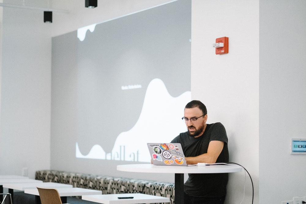 Matt at a laptop while presenting