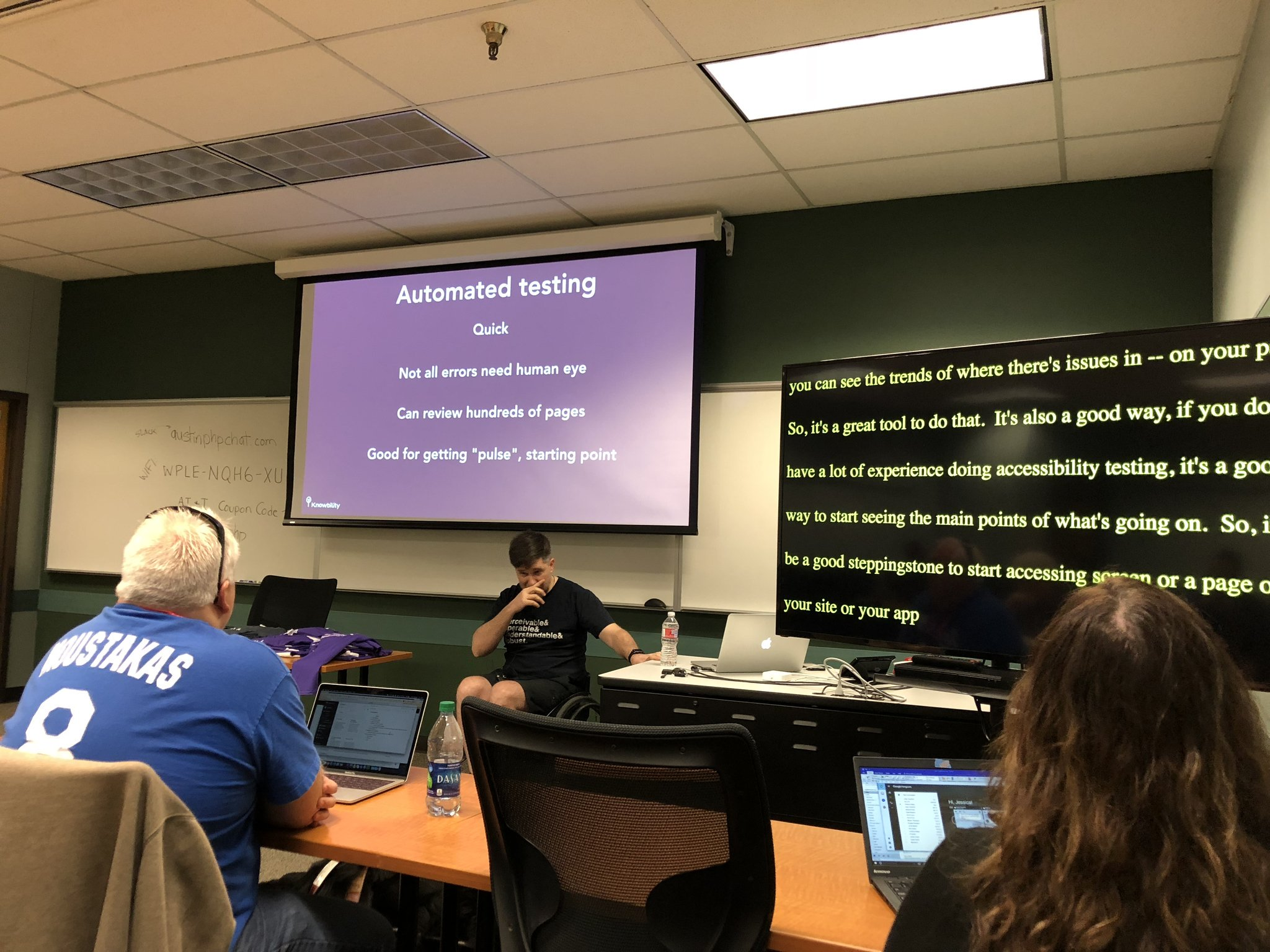 Example of live captioning. A big monitor with a captionier taking down the speaker's words in real time. The event was Longhorn PHP.