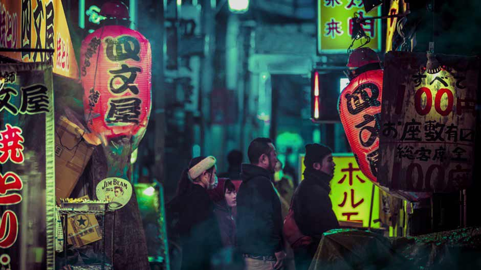 Japanese lanterns lining an alleyway at night
