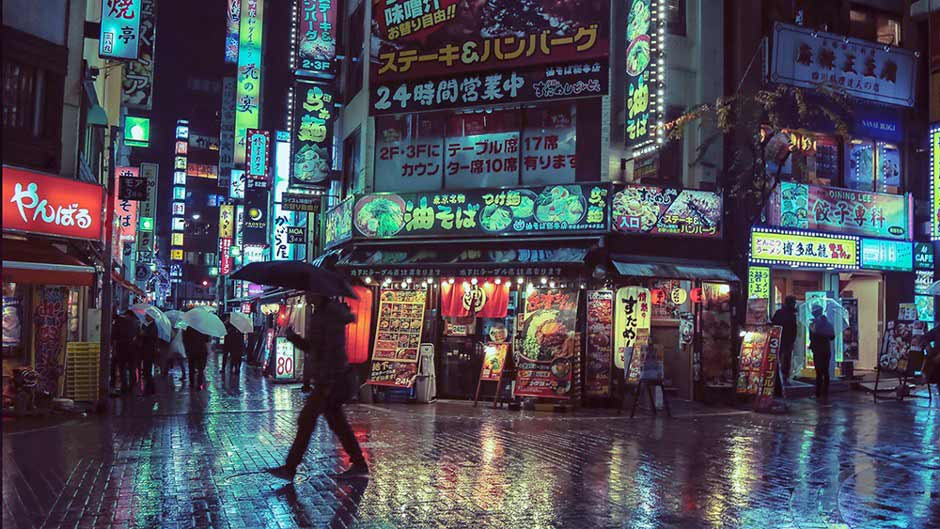 A neon-lit shopping district in Japan