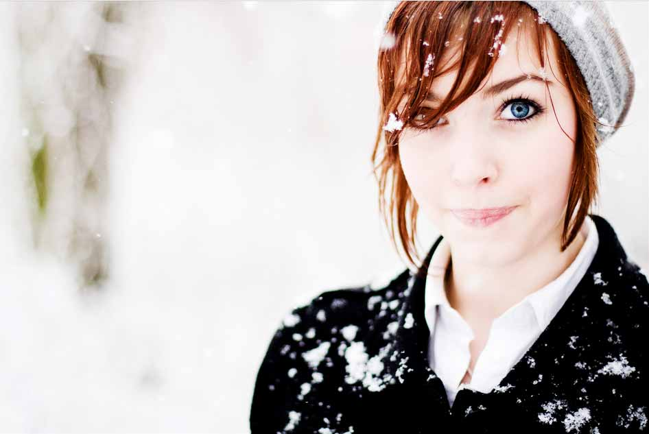 Photograph of a girl in heavy snow