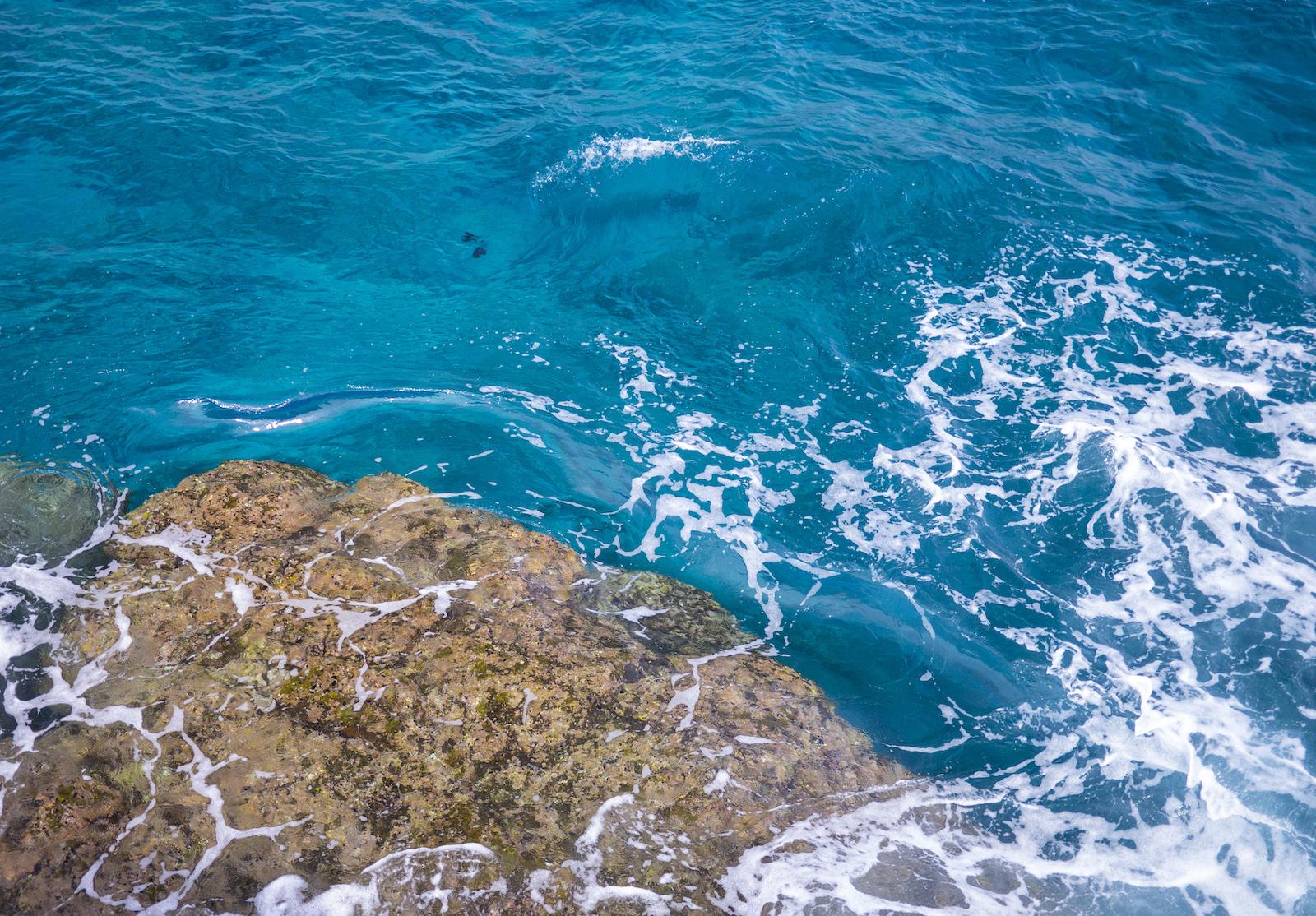 Hawaiian water crashes against the rocks