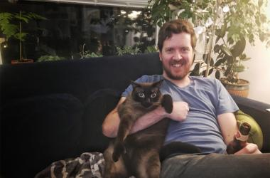 Peanut and Gregr at home on the couch