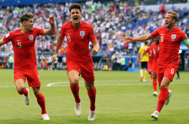 July 7, 2018; Samara, Russia; England player Harry Maguire (6) celebrates with John Stones (5) and Harry Kane (9) after scoring a goal against Sweden in the quarterfinals during the FIFA World Cup 2018 at Samara Stadium.