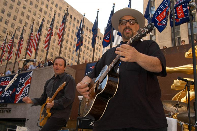 Pat DiNizio (right) performs with The Smithereens for the launch celebration of 'USA tennis month' at Rockefeller Center.