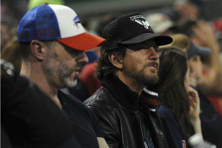 American musician, singer and songwriter Eddie Vedder watches the game between the Boston Red Sox and Chicago Cubs during the fourth inning at Fenway Park