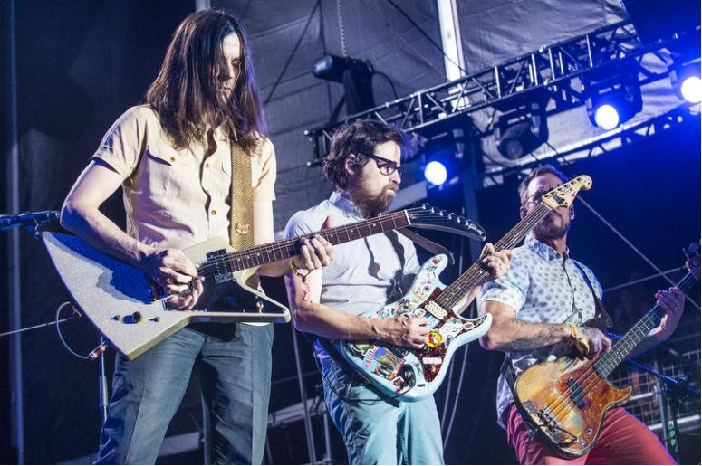 LAS VEGAS - SEP 27 : Musicians Brian Bell, Rivers Cuomo and Scott Shriner of Weezer perform onstage AT the 2015 Life Is Beautiful Festival on September 27, 2015 in Las Vegas, Nevada.