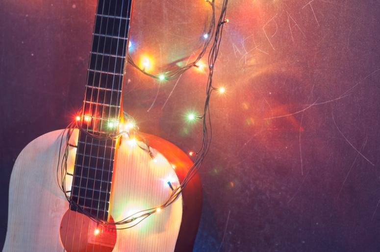 guitar + string lights - 10 Christmas Songs That Rock 107.7 The End