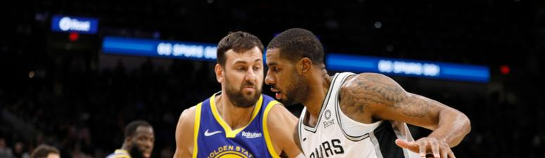 Bogut returns, but Warriors fall to the red-hot Spurs 111-105