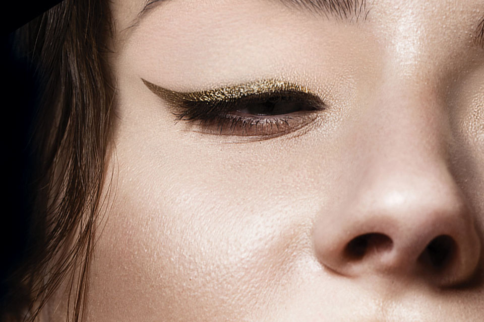 Model's eye wearing dark gold eyeliner makeup look that can be achieved with the Ibiza Nights eyeliner trio by Japonesque color cosmetics and makeup.