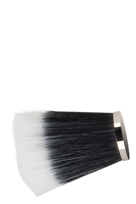 Head of a Japonesque makeup brush with black and white bristles