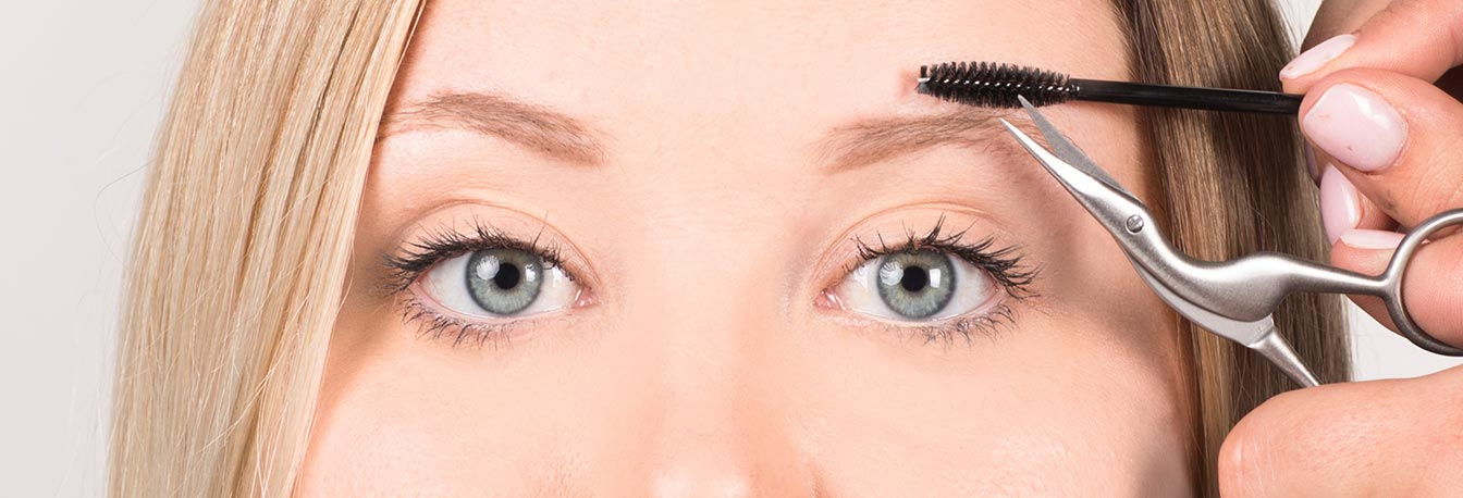 Using the brow spoolie fluff brows upwards and trim hairs with the sleek stork scissors for an even length.