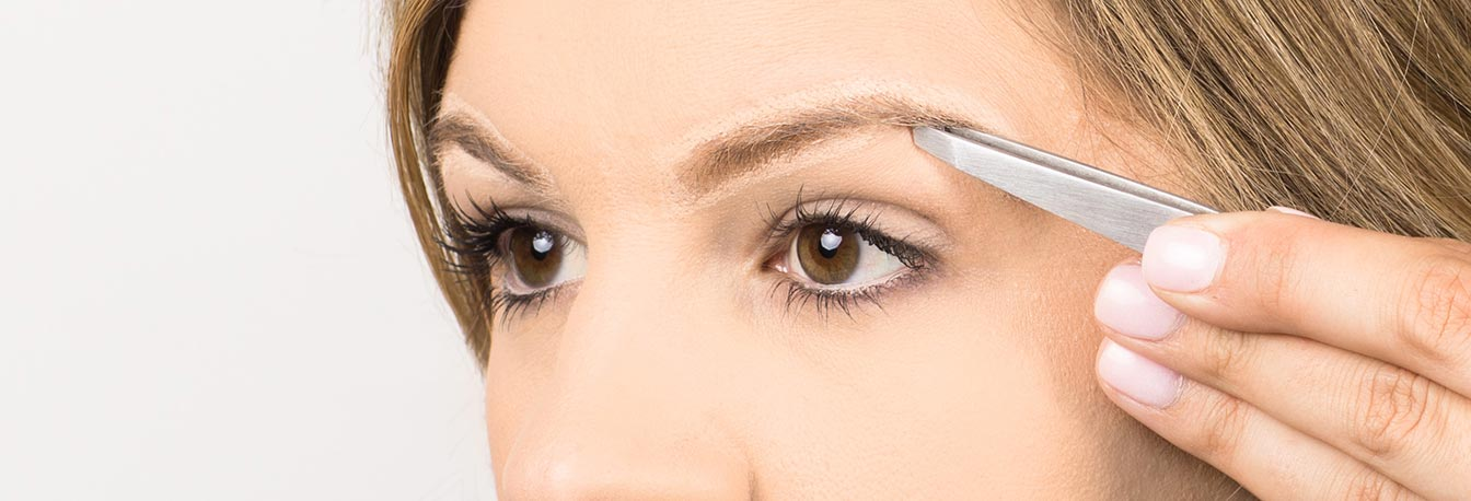 Pluck brows using the slant tweezer to remove large sections of hair plucking in the direction the hairs grow.