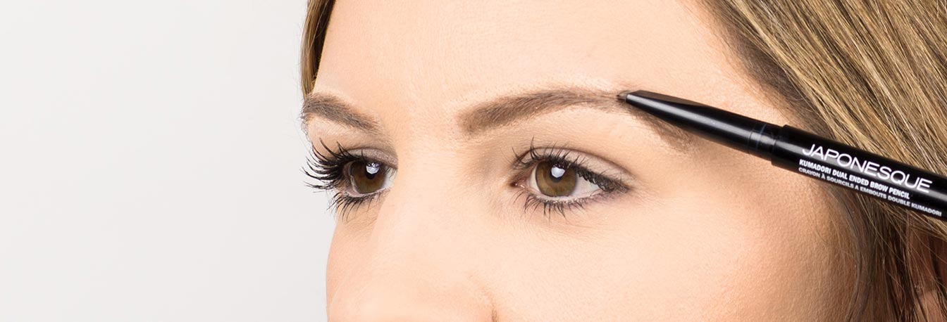 Fill in any sparse areas using the Duel Ended Brow Pencil. Comb hairs into place.
